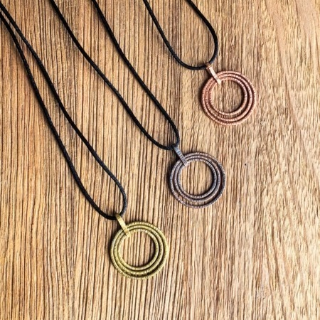 Handmade copper and brass three circle hammered pendants